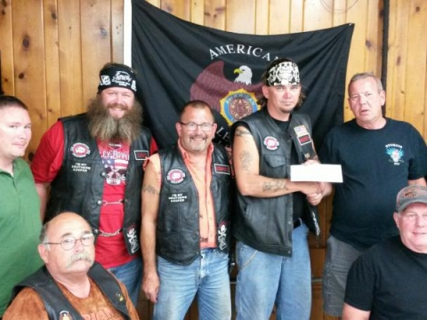 2015 Legion Riders donating to BACA
